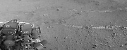The two donut-shaped tracks make an infinity symbol, and mark the first two drives of NASA's Curiosity rover.