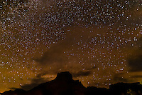 A starry sky over the Chisos Mountains in Big Bend National Park, Texas USA. Big Bend is one of the darkest areas at night in the Continental U.S. due to the lack of light pollution.