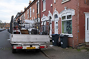 Scrap metal collector aka rag and bone truck parked on a residentail street as the second national lockdown continues with just a week before the new three tier system begins in Sparkhill on 24th November 2020 in Birmingham, United Kingdom. Metal collectors are common in Birmingham, and tour around the streets looking for items that people are throwing out, thus providing an efficient recycling system which also makes a living for the collectors. The national lockdown is a huge blow to the economy and for individual businesses who were already struggling with only offering limited services.