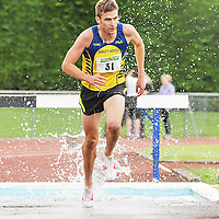 18 August 2013; Rory Chesser, Clare Athletics, on his way to winning the Men's 3000m Steeplechase Division One, at the Woodie's DIY National Track and Field League Final 2013. Tullamore Harriers, Tullamore, Co. Offaly. Picture credit: Tomas Greally / SPORTSFILE *** NO REPRODUCTION FEE ***
