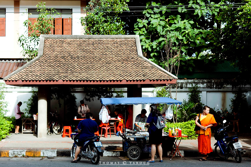 A monk of Chiang Mai and a street vendor
