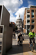 Unicycle and St. Paul's Cathedral in the City of London.
