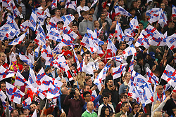 England fans wave their flags in the stands