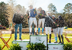 March 22, 2019 - Raeford, North Carolina, US - March 23, 2019 - Raeford, N.C., USA - All of the podium winners in divisions CCI-4S through CCI-2S douse each other with champagne at the sixth annual Cloud 11-Gavilan North LLC Carolina International CCI and Horse Trial, at Carolina Horse Park. The Carolina International CCI and Horse Trial is one of North AmericaÃ•s premier eventing competitions for national and international eventing combinations, hosting International competition at the CCI2*-S through CCI4*-S levels and National levels of Training through Advanced. (Credit Image: © Timothy L. Hale/ZUMA Wire)