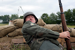 A German infantryman raises the alarm as enemy forces advance on thier positions at the Ponderosa Wartime Weekend Heckmondwike<br /> 10th July 2011<br /> Image © Paul David Drabble