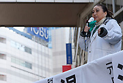 Japanese celebrity, Reiko Yukawa, campaingning for the anti-nuclear candidate and former Prime Minsister of Japan, Morihiro Hosokawa, in the 2014 Tokyo Gubernatorial Elections. Ikebukero, Tokyo, Japan. Friday, February 7th 2014
