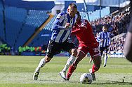 Sheffield Wednesday defender Jack Hunt (32) takes on Cardiff City midfielder, Kadeem Harris (24) during the Sky Bet Championship match between Sheffield Wednesday and Cardiff City at Hillsborough, Sheffield, England on 30 April 2016. Photo by Ellie Hoad.
