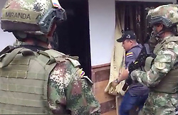 "EXCLUSIVE: *NO WEB UNTIL 11PM BST SEPT 2ND* The dramatic moment British 'drugs baron' Andrew Deamer is arrested in Colombia for allegedly smuggling cocaine worth £345 million hidden in DOG FOOD. Deamer, 52, now faces 14 years in a Colombian prison after being seized in a dramatic 6am raid on his isolated home outside Medellin - the city made infamous by infamous cartel boss Pablo Escobar. The Brit is now in Bogota's infamous La Picota prison after signing a 'pre-agreement' to accept a sentence of 14 years and eight months in return for co-operating with authorities to ""name names.' Deamer, originally from Barrow upon Soar, Leics, ran a syndicate that converted at least 2.5 tons of cocaine into a substance that resembled dog food, down to the look, smell and texture, say Colombian authorities. He was snared by anti-narcotics agents backed up by Colombian army and navy troops. Deamer is seen climbing down from his attic bolt-hole after being busted in a dramatic 6am raid by Colombian forces. Wearing shorts and T-shirt, he had darted into the secret hideaway after realising anti-narcotics agents and army and navy troops were closing in on his remote farmhouse. His capture was videoed by The Fiscalia, Colombia's Office of the Attorney General. Deamer, who also spent time living in Florida, is said to have recruited specialist chemists for the cocaine transformation and they followed the shipments to Europe to extract the cocaine at the destinations. His second wife, Colombian Marcela Zapata, 37, was arrested with him. 02 Sep 2018 Pictured: Arrest of Andrew Deamer. Photo credit: Greg Woodfield / MEGA TheMegaAgency.com +1 888 505 6342"