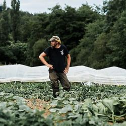 "Frederik Anciot in his vegetable garden, ""le potager de Frugie"". Saint-Pierre-de-Frugie, France. July 12, 2019.<br /> Frederik Anciot prenant la pose dans son ""potager de Frugie"". Saint-Pierre-de-Frugie, France. 12 juillet 2019."