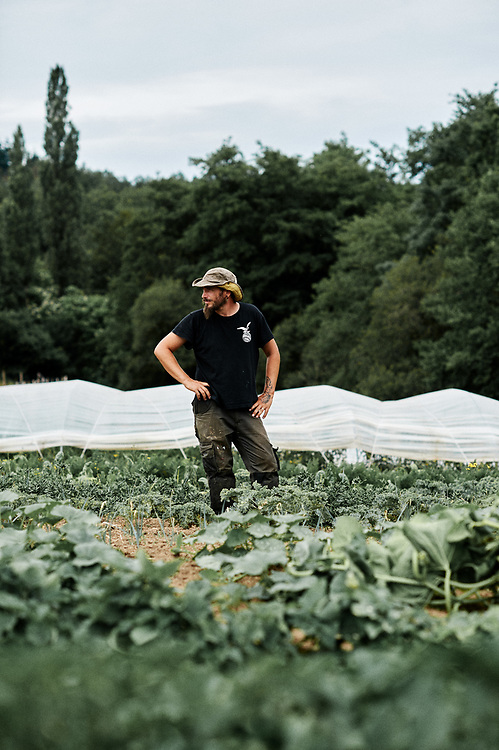 "Frederik Anciot in his vegetable garden, ""le potager de Frugie"". Saint-Pierre-de-Frugie, France. July 12, 2019.<br /> Frederik Anciot prenant la pose dans son ""potager de Frugie"". Saint-Pierre-de-Frugie, France. 12 juillet 2019."