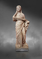 Roman statue of women. Perge. 2nd century AD. inv 3270 . Antalya Archaeology Museum; Turkey. Against a grey background .<br /> <br /> If you prefer to buy from our ALAMY STOCK LIBRARY page at https://www.alamy.com/portfolio/paul-williams-funkystock/greco-roman-sculptures.html . Type -    Antalya     - into LOWER SEARCH WITHIN GALLERY box - Refine search by adding a subject, place, background colour, museum etc.<br /> <br /> Visit our ROMAN WORLD PHOTO COLLECTIONS for more photos to download or buy as wall art prints https://funkystock.photoshelter.com/gallery-collection/The-Romans-Art-Artefacts-Antiquities-Historic-Sites-Pictures-Images/C0000r2uLJJo9_s0