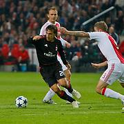 NLD/Amsterdam/20100928 - Champions Leaguewedstrijd Ajax - AC Milan, Miralem Sulejmani in duel met Andrea Pirlo