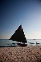 Silhouette of sailboat sitting on White Sand Beach, boracay island, Philippines in the late afternoon.