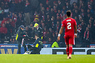 Security wrestles with a pitch invader during the Betfred Cup Final between Celtic and Aberdeen at Celtic Park, Glasgow, Scotland on 2 December 2018.