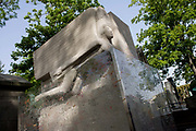 """Celebrated grave for the Dublin-born playright and known homosexual, Oscar Wilde in the Pere Lachaise cemetery, Paris. 19th century Irish playwright and wit Oscar Wilde once quipped: """"One can survive anything these days, except death, and live down anything except a good reputation."""" He died in Paris at only 46, impoverished and broken down from years of being villified by Victorian society. He was buried at Père Lachaise with a modest tomb, but a memorial was later erected. Today the monument is covered in lipstick marks left by ardent visitors. Père Lachaise Cemetery (French: Cimetière du Père-Lachaise- or officially cimetière de l'Est, """"East Cemetery"""") is the largest cemetery in the city of Paris, France (44 hectares (110 acres) containing the remains of a million French and foreign dead."""