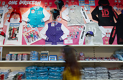 © Licensed to London News Pictures. 28/03/2013. London, UK. One Direction merchandise is seen at the 'One Direction World' pop-up shop which opened today (28/03/2013) at the O2 dome in Greenwich London today. Photo credit: Matt Cetti-Roberts/LNP
