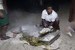 Traditional Fijian Dinner Cooked on Hot Coals in the Sand, Turtle Island, Yasawa Islands, Fiji