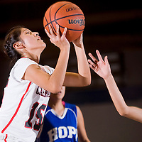 012513       Cable Hoover<br /> <br /> St Michaels Cardinal Kayola Denny (15) jumps past Hopi Bruin Natasha Richardson (14) for a layup Friday at the Window Rock Sports Center.