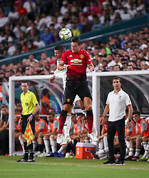 July 31, 2018 - Miami Gardens, Florida, USA - Manchester United F.C. defender Matteo Darmian (36) leaps to head the ball with Real Madrid C.F. defender Theo Hernandez (15) during an International Champions Cup match between Real Madrid C.F. and Manchester United F.C. at the Hard Rock Stadium in Miami Gardens, Florida. Manchester United F.C. won the game 2-1. (Credit Image: © Mario Houben via ZUMA Wire)