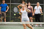 A weight loss camper plays tennis during a weight loss program at Camp Shane, Catskill Mountains, New York.