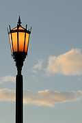 A light is lit as the sun sets in Kapi'olani Park in Waikiki.