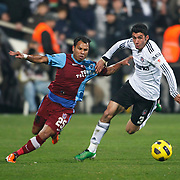 Besiktas's Ismail KOYBASI (R) and Trabzonspor's Alan Carlos Gomes Da COSTA (L) during their Turkey Cup Group B matchday 5 soccer match Besiktas between Trabzonspor at the Inonu stadium in Istanbul Turkey on Wednesday 26 January 2011. Photo by TURKPIX