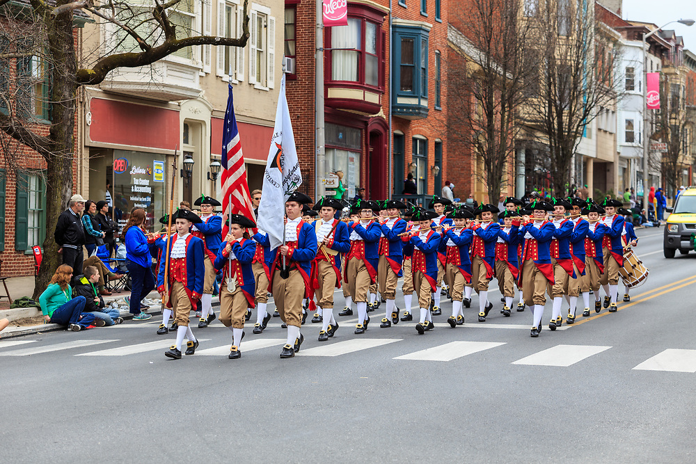 York, PA / USA- March 12, 2016: Early American colonial reenactors march in the annual Saint Patrick's Day Parade.York, Pennsylvania.