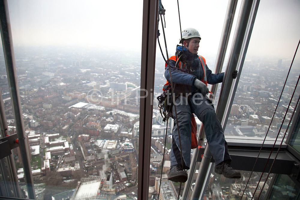 London, UK. Wednesday 23rd January 2013. An abseiler works on the exterior of ths building at The View from The Shard. This visitor attraction is the highest vantage point from any building in Western Europe and casts stunning views across the capital. The public viewing deck on level 69 and 72 offers a 360 degree view of the city.