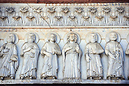 Late medieval relief sculptures of the typanuim of the main door depicting St Mary and the Apostles , the Cattedrale di San Martino,  Duomo of Lucca, Tunscany, Italy, .<br /> <br /> Visit our ITALY HISTORIC PLACES PHOTO COLLECTION for more   photos of Italy to download or buy as prints https://funkystock.photoshelter.com/gallery-collection/2b-Pictures-Images-of-Italy-Photos-of-Italian-Historic-Landmark-Sites/C0000qxA2zGFjd_k<br /> <br /> <br /> Visit our MEDIEVAL PHOTO COLLECTIONS for more   photos  to download or buy as prints https://funkystock.photoshelter.com/gallery-collection/Medieval-Middle-Ages-Historic-Places-Arcaeological-Sites-Pictures-Images-of/C0000B5ZA54_WD0s .<br /> <br /> If you prefer to buy from our ALAMY PHOTO LIBRARY  Collection visit : https://www.alamy.com/portfolio/paul-williams-funkystock/lucca.html .
