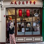 Tourists enjoy London Chinatown Sweet Tooth Cafe and Restaurant at Newport Court and Garret Street on 15 June 2019, UK.