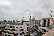 Construction cranes on a London Skyline building the new Google offices in Kings Cross, London, United Kingdom.