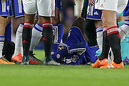 Kurt Zouma of Chelsea lies in pain injured after falling awkwardly as he attempted  to control the ball in the air.. Barclays Premier league match, Chelsea v Manchester Utd at Stamford Bridge in London on Sunday 7th February 2016.<br /> pic by John Patrick Fletcher, Andrew Orchard sports photography.