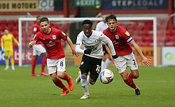 Siriki Dembele of Peterborough United gets away from Tom Lowery and Perry Ng of Crewe Alexandra - Mandatory by-line: Joe Dent/JMP - 14/11/2020 - FOOTBALL - Alexandra Stadium - Crewe, England - Crewe Alexandra v Peterborough United - Sky Bet League One