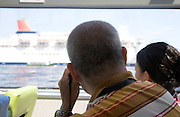tourist taking picture of a large ocean passenger cruise ship