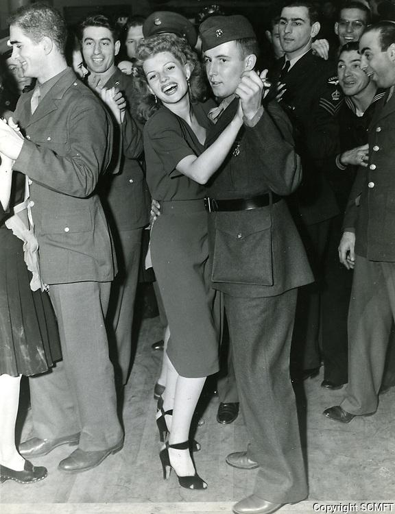12/10/42 Rita Hayworth dancing with a serviceman at the Hollywood Canteen