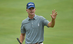 July 15, 2018 - Silvis, Illinois, U.S. - SILVIS, IL - JULY 15:  Chris Treelman acknowledges the applause of the crowd after hitting a birdie putt on the #1 green during the final round of the John Deere Classic on July 15, 2018, at TPC Deere Run, Silvis, IL.  (Photo by Keith Gillett/Icon Sportswire) (Credit Image: © Keith Gillett/Icon SMI via ZUMA Press)