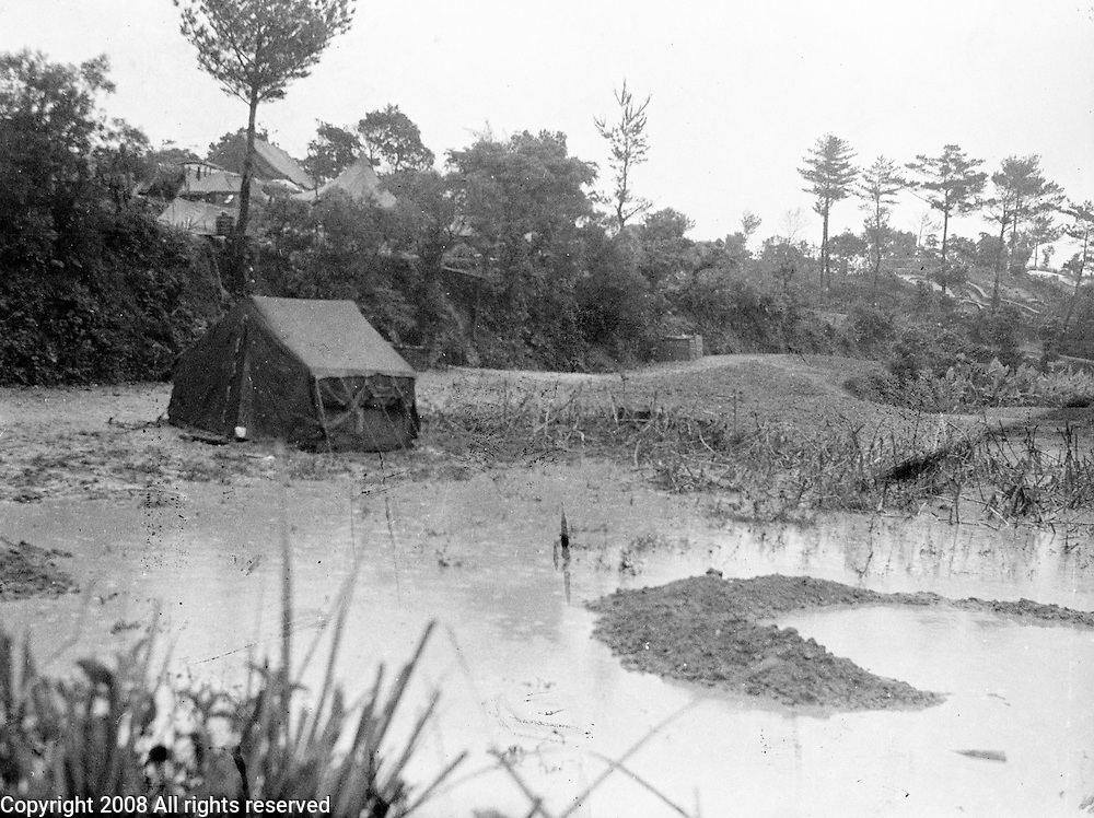 Rain storm in swamp in a photograph made on Okinawa in circa 1945 after the U.S. invasion.