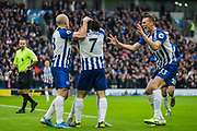 Alireza Jahanbakhsh (Brighton) celebrates his goal 1-0 with Aaron Mooy (Brighton), Neal Maupay (Brighton) & Dan Burn (Brighton) during the Premier League match between Brighton and Hove Albion and Bournemouth at the American Express Community Stadium, Brighton and Hove, England on 28 December 2019.