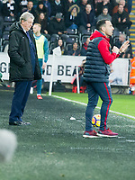 Football - 2017 / 2018 Premier League - Swansea City vs. Crystal Palace<br /> <br /> Crystal PalaceRoy Hodgson manager & Swansea City acting manager Leon Britton on the touchline, at the Liberty Stadium.<br /> <br /> COLORSPORT/WINSTON BYNORTH