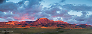 Panoramic of fiery sunrise light striking Ear Mountain along the Rocky Mountain Front near Choteau, Montana, USA