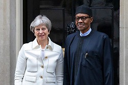 © Licensed to London News Pictures. 16/04/2018. London, UK. Prime Minister Theresa May (L) and Nigerian President Muhammadu Buhari (R) stand on the steps of 10 Downing Street. Photo credit: Rob Pinney/LNP