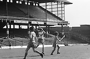 Players waiting with hurls at the ready as the slitor is hit towards them during the All Ireland Senior Camogie Final Cork v Wexford in Croke Park on the 21st September 1975. Wexford 4-3 Cork 1-2.