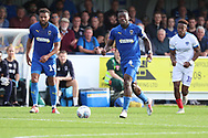 AFC Wimbledon defender Deji Oshilaja (4) dribbling during the EFL Sky Bet League 1 match between AFC Wimbledon and Portsmouth at the Cherry Red Records Stadium, Kingston, England on 13 October 2018.