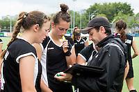 BREDA (Neth.)  Coach Sean Dancer  with  captain Pippa Norman (l) and Stephanie Dickins (m) during the match  New Zealand vs England U21 women . Volvo Invitational Tournament U21. COPYRIGHT KOEN SUYK