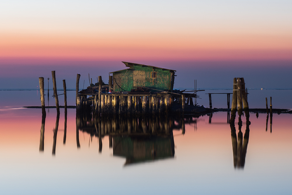 """A """"Cason"""", the typical temporary house of the Venetian fishermen, is seen in the southern lagoon of Venice, in front of the island of Pellestrina."""