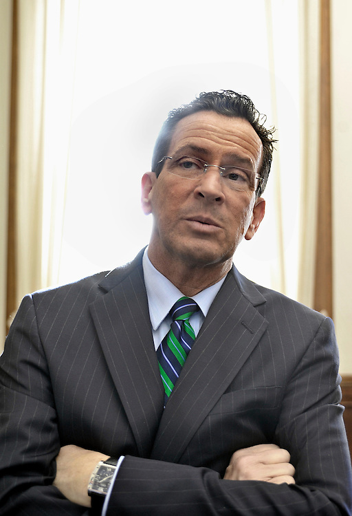 Connecticut Gov. Dannel P. Malloy stands outside his office after holding his first news conference as governor at the Capitol in Hartford, Conn., Thursday, Jan. 6, 2011.  (AP Photo/Jessica Hill)