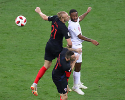 July 11, 2018 - Moscow, Russia - July 11, 2018, Moscow, FIFA World Cup 2018 Football, the playoff round. 1/2 finals of the World Cup. Football match Croatia - England at the stadium Luzhniki. Player of the national team Domagoy Vida; Raheem Stirling. (Credit Image: © Russian Look via ZUMA Wire)