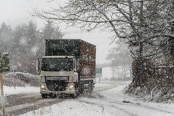 © Licensed to London News Pictures. 29/12/2020. Llanfihangel Nant Melan, Powys, Wales, UK.A truck drives through winter weather on the A44 road near Llanfihangel Nant Melan in Powys, Wales, UK. Photo credit: Graham M. Lawrence/LNP