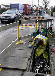 © Licensed to London News Pictures. 03/01/2013. 700 homes in the borough of Bromley,Kent are still without gas for a fifth day today (03.01.2013) after a burst water main in Locksbottom on Crofton Road (A232)  has wreaked havoc with the supply.  .Southern Gas Networks (SNG) has reconnected 950 of the 1,650 homes affected, having extracted 95,000 litres of water from gas pipes..The water main, located in Crofton Road, burst on Christmas Eve, causing water to leak into gas pipes..Local residents have been without gas since December 30..pic:Gas engineers working to repair the damage on Crofton Road  as the traffic backs up..today.Photo credit : Grant Falvey/LNP