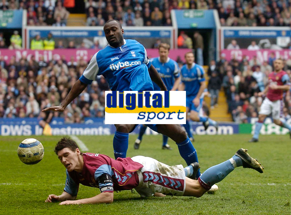 Photo: Glyn Thomas.<br />Aston Villa v Birmingham City. The Barclays Premiership. 16/04/2006.<br /> Birmingham City's Olivier Tebily (top) and Villa's Liam Ridgewell.